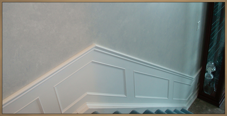 Raised Wainscoting for stairway, painted white with steel blue faux finished walls
