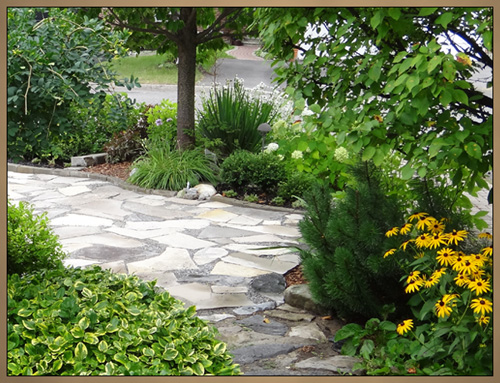 Custom Landscaping With Lighting Daytime Photo
